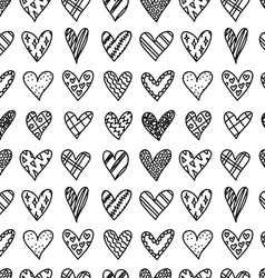 Hand drawn seamless pattern with doodle hearts vector