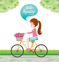 Girl riding bicycle with flower in basket vector
