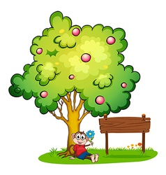A monkey sitting under the tree beside the empty vector image vector image