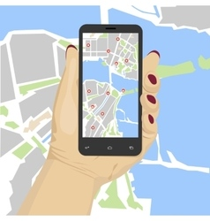 Hand holding smartphone with mobile gps vector