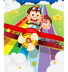 Two monkeys riding in an aircraft vector image