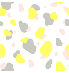 Seamless pattern of yellow gray and pink spots vector