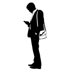 silhouette of a man in a business suit with phone vector image