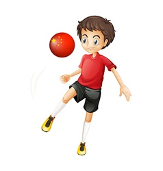 A boy using the soccer ball with the flag of China vector image vector image