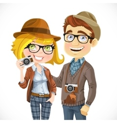 Couple of hipsters in hats with a camera isolated vector