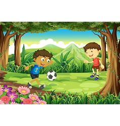 A forest with two boys playing soccer vector