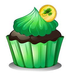 A chocolate cupcake with a coin at the top vector image vector image