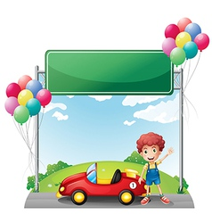 A boy with his red car below an empty board vector