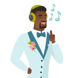 African groom listening to music in headphones vector