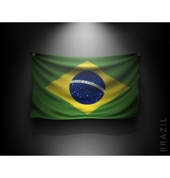 Waving flag brazil on a dark wall vector