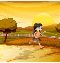 A girl running along the field vector image