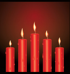 Realistic red glowing candles with melted wax vector