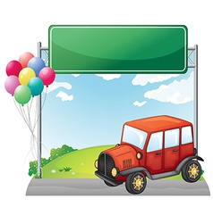 A red car along the street with a green signage vector image