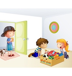 Three kids inside the house with a box of toys vector image
