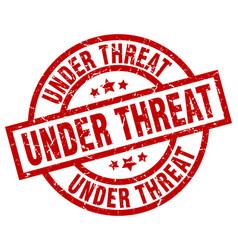 under threat round red grunge stamp vector image vector image