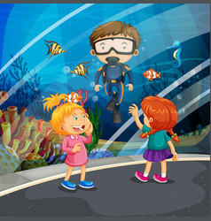 girls looking at fish and diver in the aquarium vector image