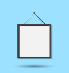 Realistic photo frame isolated on blue background vector