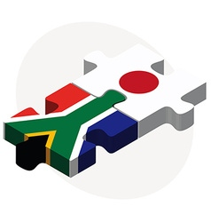 South africa and japan flags in puzzle vector
