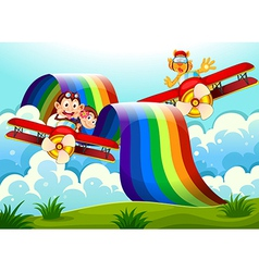 Playful animals near the rainbow above the hills vector image vector image