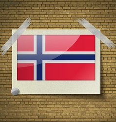 Flags norwayat frame on a brick background vector