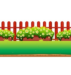 Flowers and fence in the garden vector