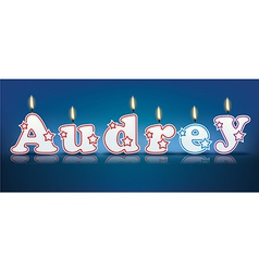 Audrey written with burning candles vector