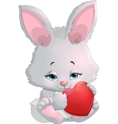 Cute bunny holding a heart vector