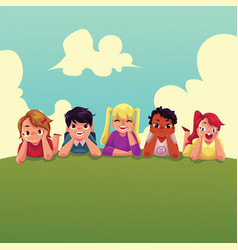 Group of happy children lying on green grass vector