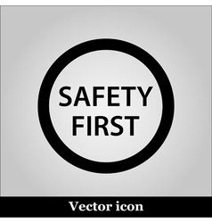 Black round safety first icon on grey background vector