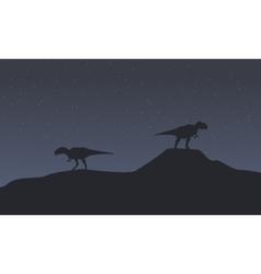 Two mapusaurus at night scenery vector