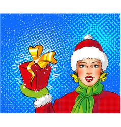 Pop art girl in santa costume holding gift vector