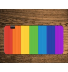 Rainbow yoga mat on wood texture floor vector