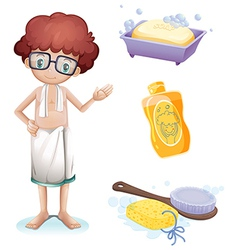 A boy with a soap shampoo brush and sponge vector image