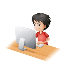 A young boy using the computer vector