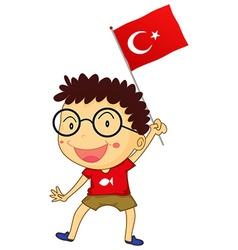 Boy holding Turkey flag vector image