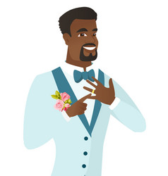 Cheerful groom showing golden ring on his finger vector