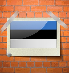 Flags estonia scotch taped to a red brick wall vector