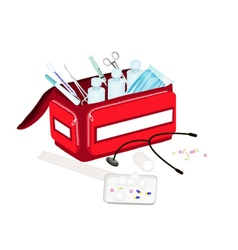 Open first aid box with medical supplies vector