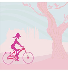 Slim woman with bicycle in a park vector