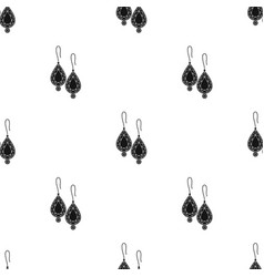 Earrings with gems icon in black style isolated on vector