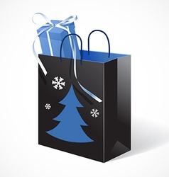Festive black paper-bag with christmas tree vector