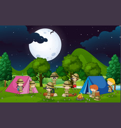 Many kids camping out in the woods at night vector