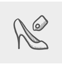 Shoe with tag sketch icon vector