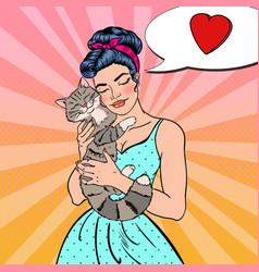 Pop art young beautiful woman embracing cat vector