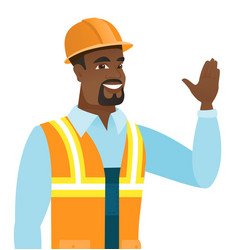 Young african-american builder waving his hand vector