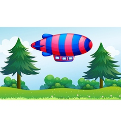A colorful aircraft above the hills vector image vector image