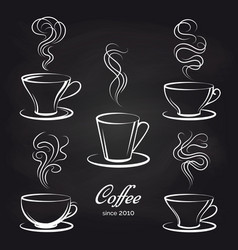Coffee cups with smoke on blackboard vector
