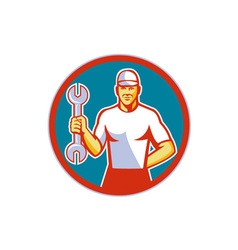 Mechanic holding wrench circle retro vector