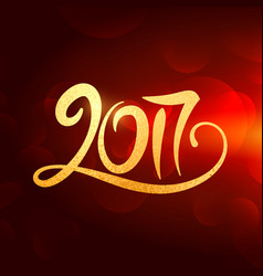 2017 new year lettering in gold color on red vector