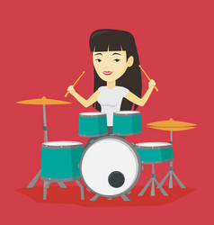 woman playing on drum kit vector image